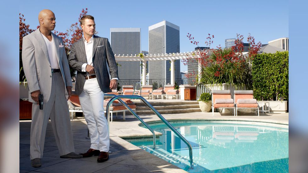 Chris O'Donnell and LL COOL J poolside in fine suits