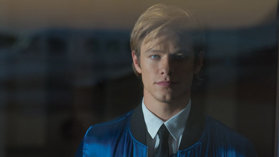 Lucas Till of MacGyver looks stoically at the camera