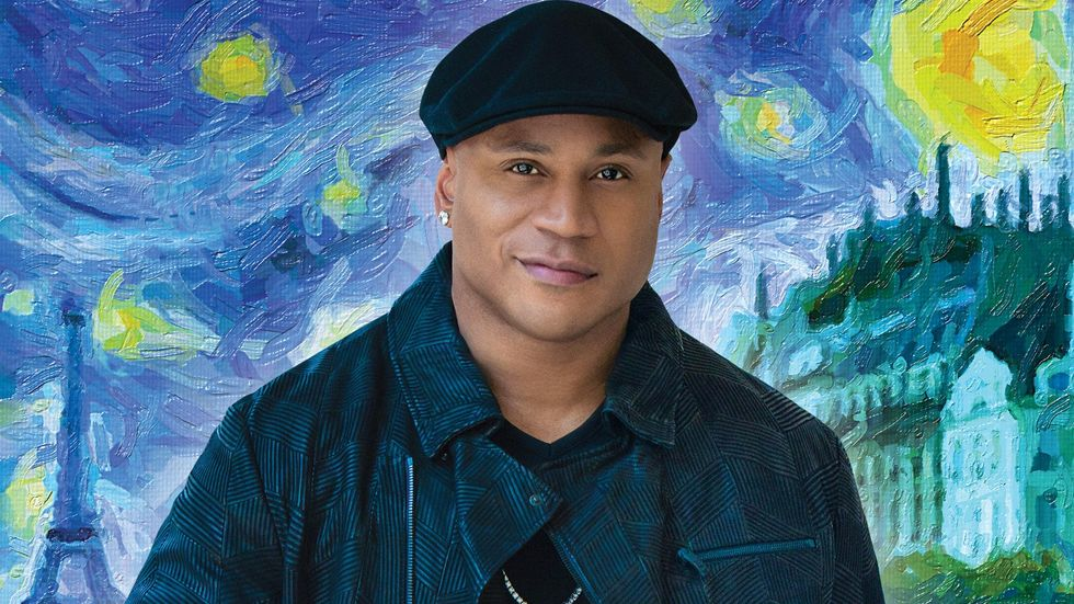 LL COOL J looking straight ahead in front of a painted background of the Eiffel Tower