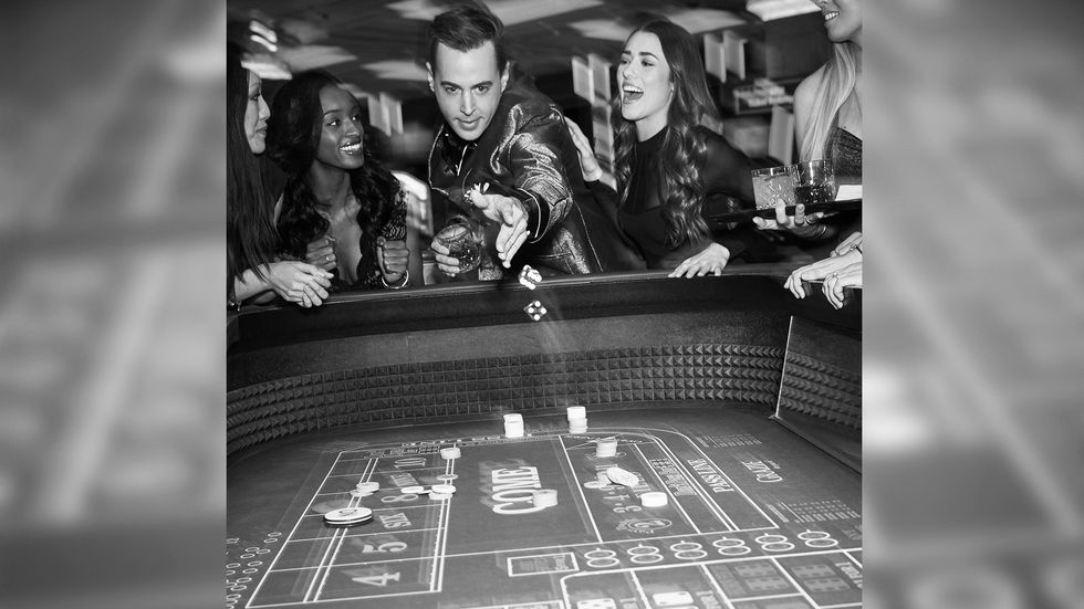 Sean Murray in black and white photo with two women at a craps table