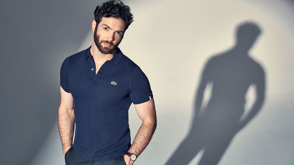 Ethan Peck of Star Trek Discovery poses in a tight Izod shirt