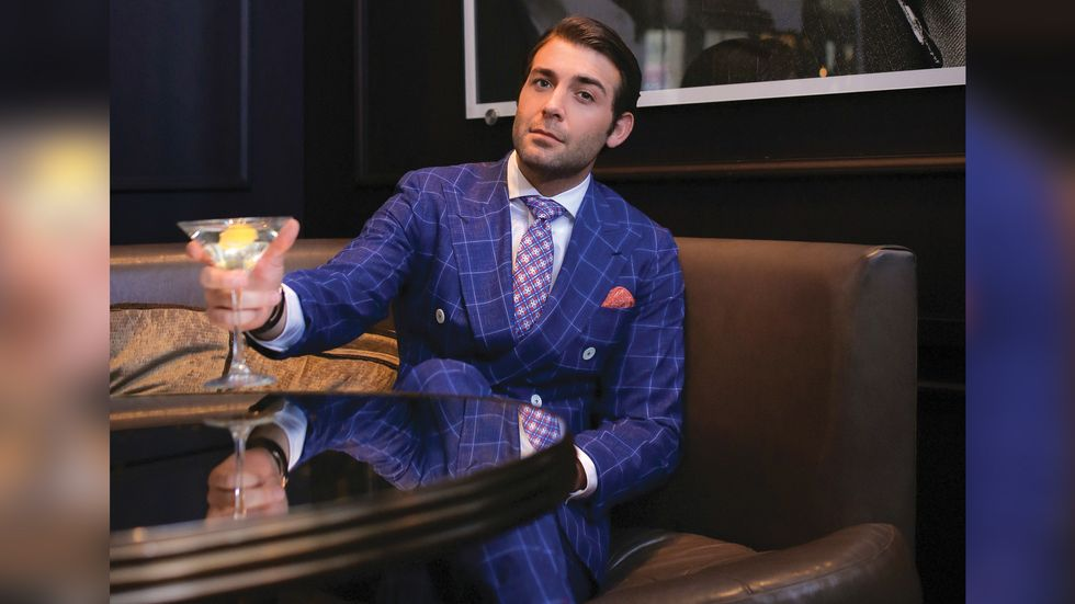 James Wolk of Tell Me A Story lounges with a martini