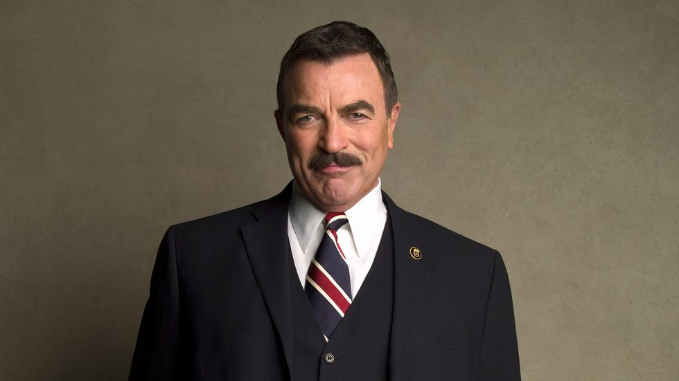 Tom Selleck in navy suit with striped tie