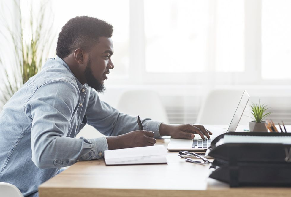 Professional man doing a gap analysis for his career development plan