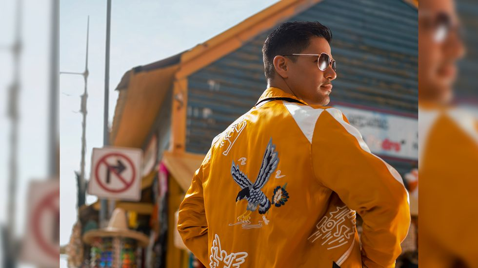 Jay Hernandez in yellow jacket with sunglasses