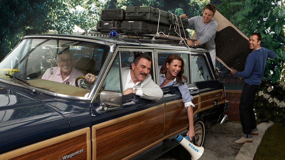 Family in vintage Jeep Wagoneer