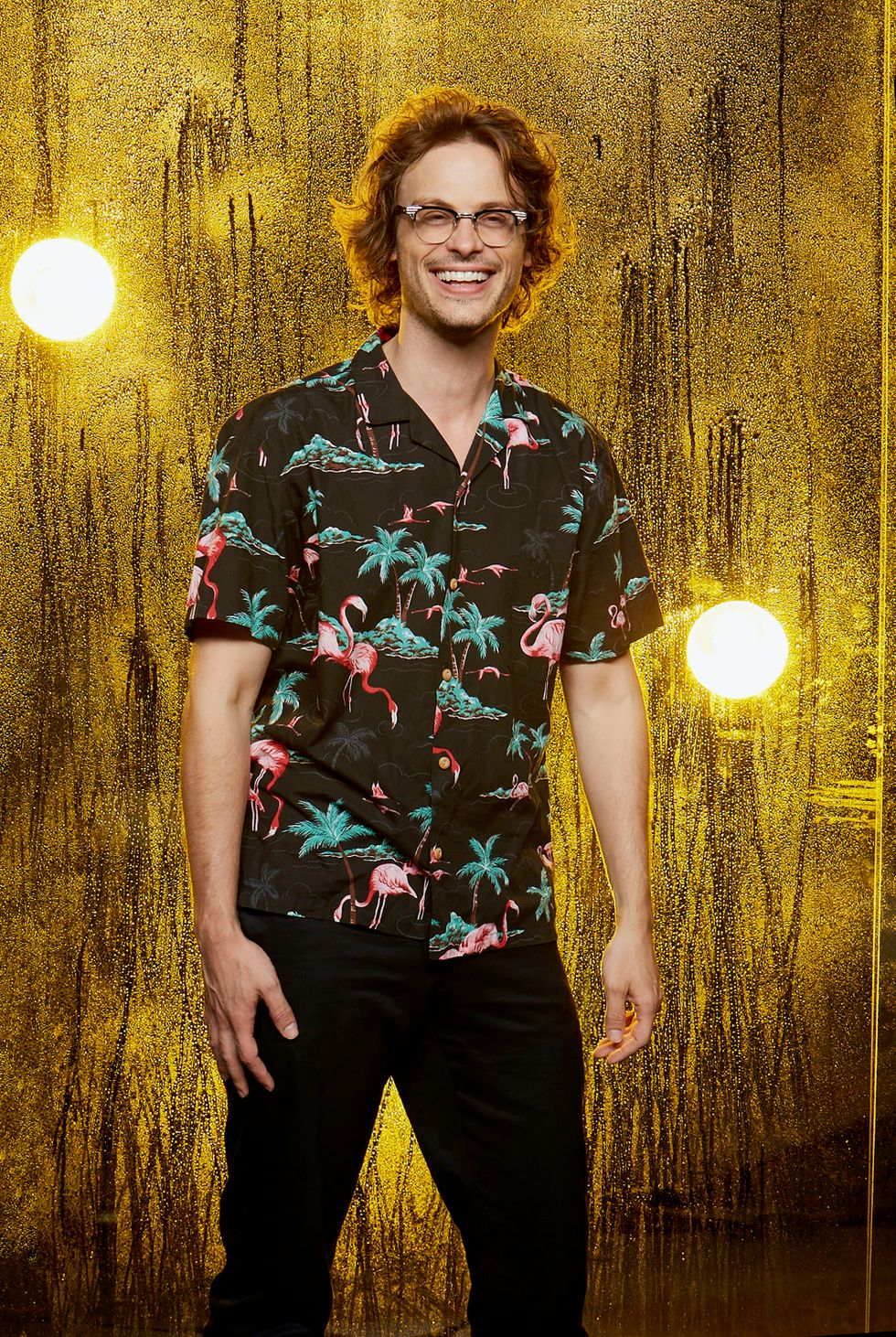 Matthew Gray Gubler of Criminal Minds in tropical shirt with palm trees and flamingos