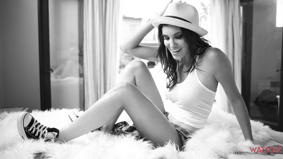 Daniela Ruah of NCIS Los Angeles in straw fedora and sneakers