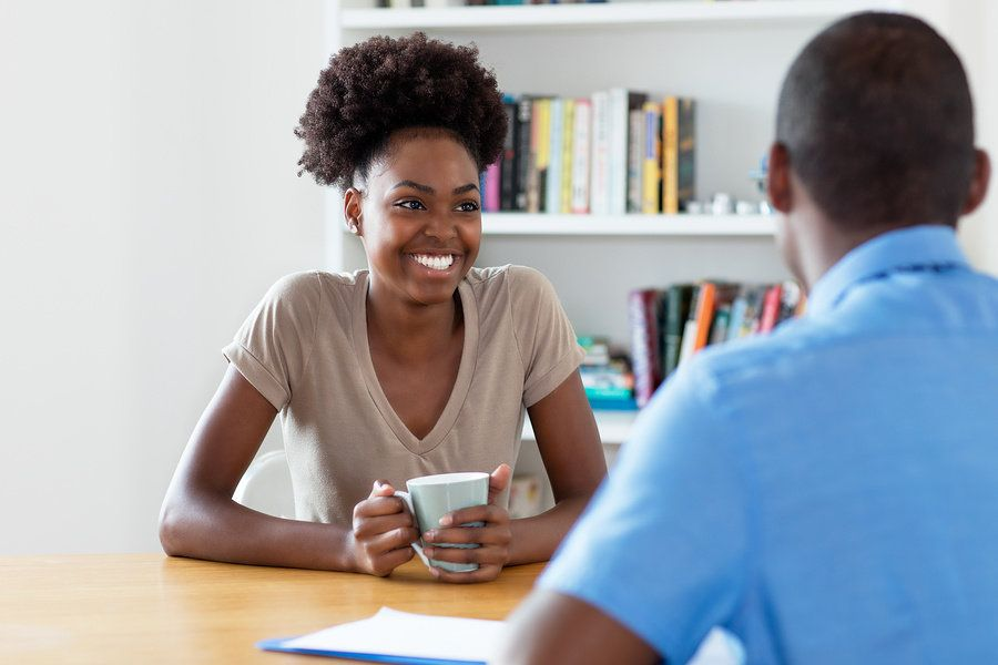 A woman helps her friend by doing a mock interview