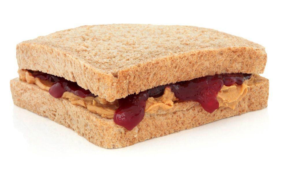 Close up of a peanut butter and strawberry jelly sandwich