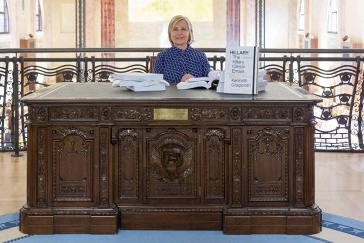 Hillary showed us what might have been as she sat at an Oval Office desk at an art exhibit