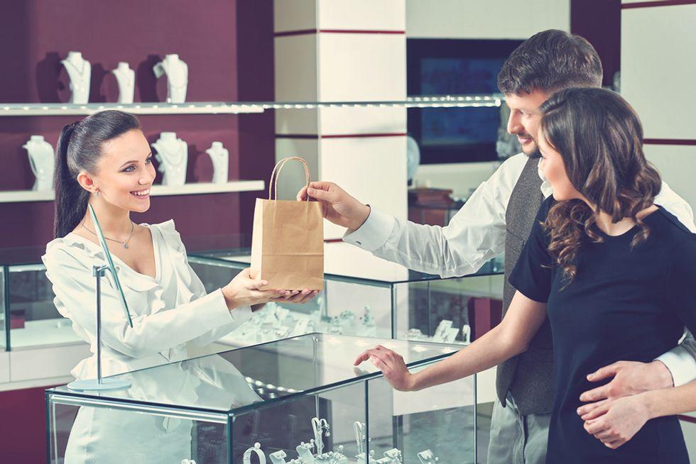 Young woman works a seasonal retail job during the holiday season.