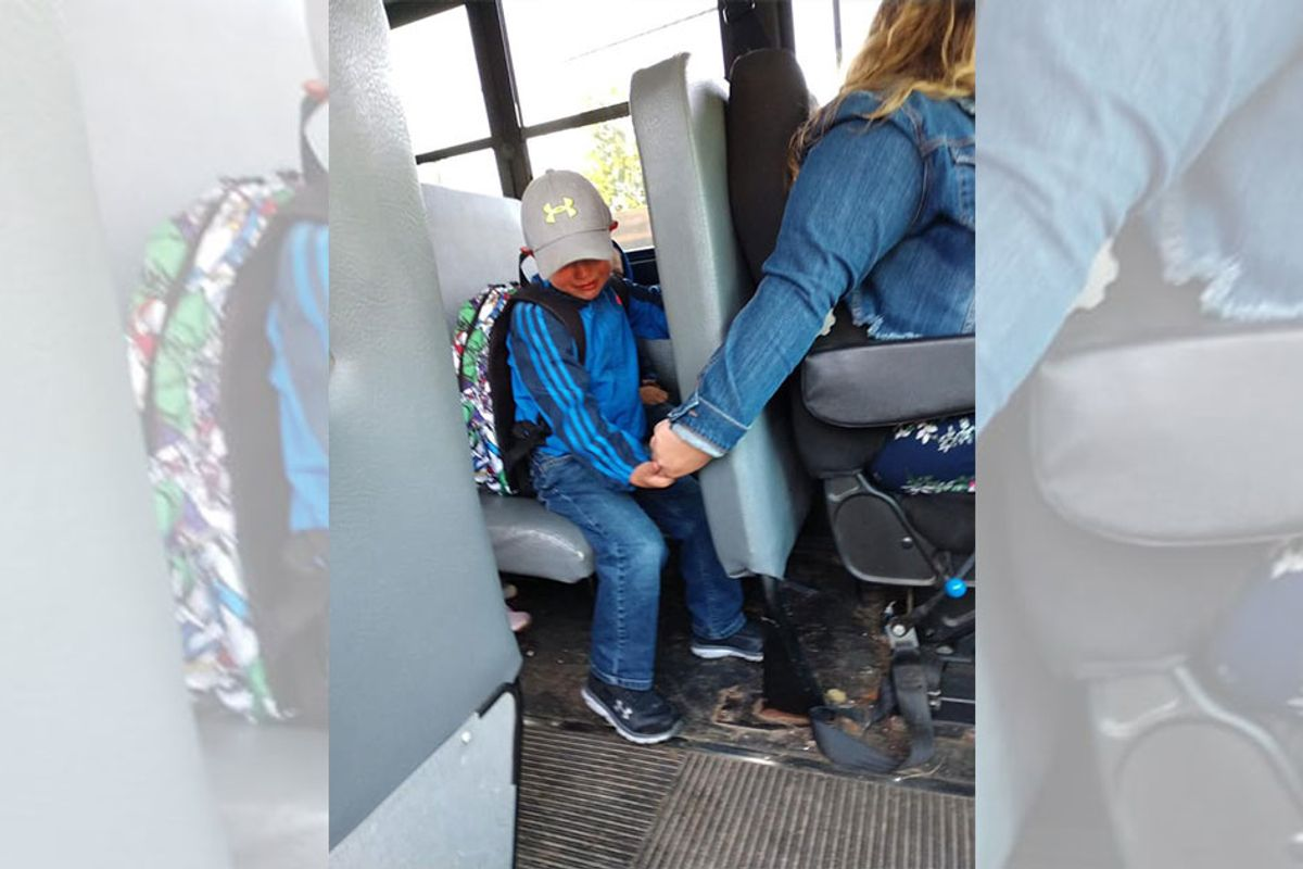 Bus driver comforts scared boy on his first day of kindergarten in heartwarming photo