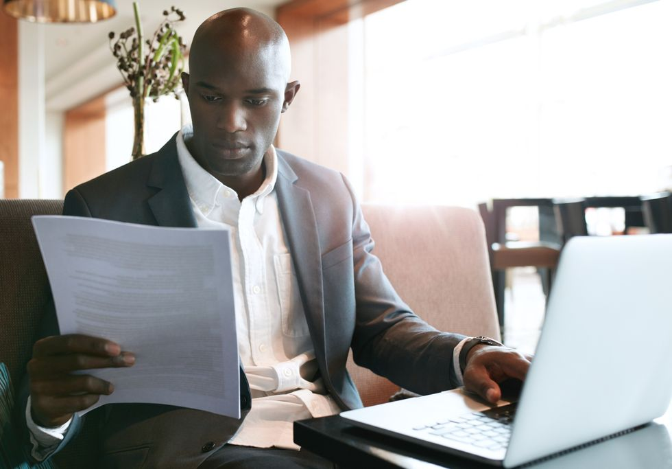 Job seeker creating detailed executive resume