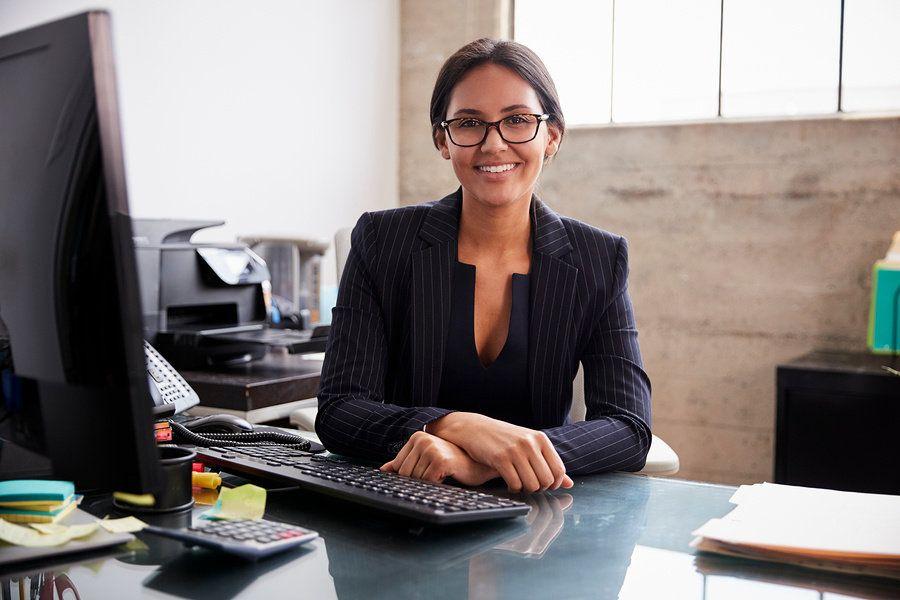 Female management analyst at her desk.