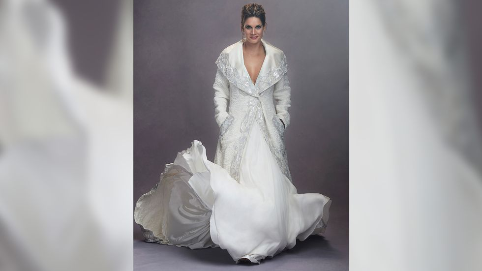 Missy Peregrym of FBI in a white gown and matching brocade evening coat