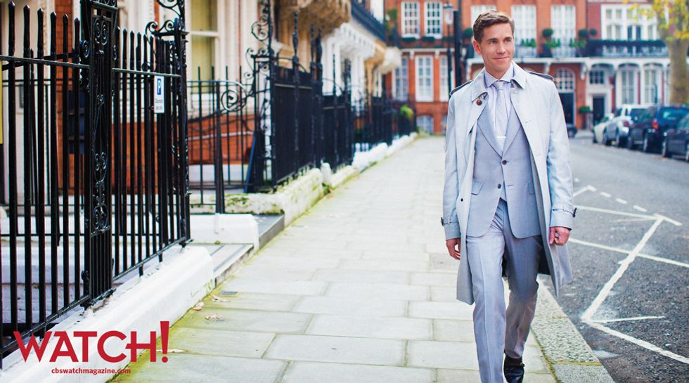 Brian Dietzen in a baby blue suit walking down the street in London