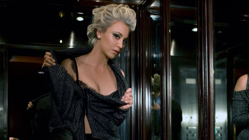 Kaley Cuoco in black dress with