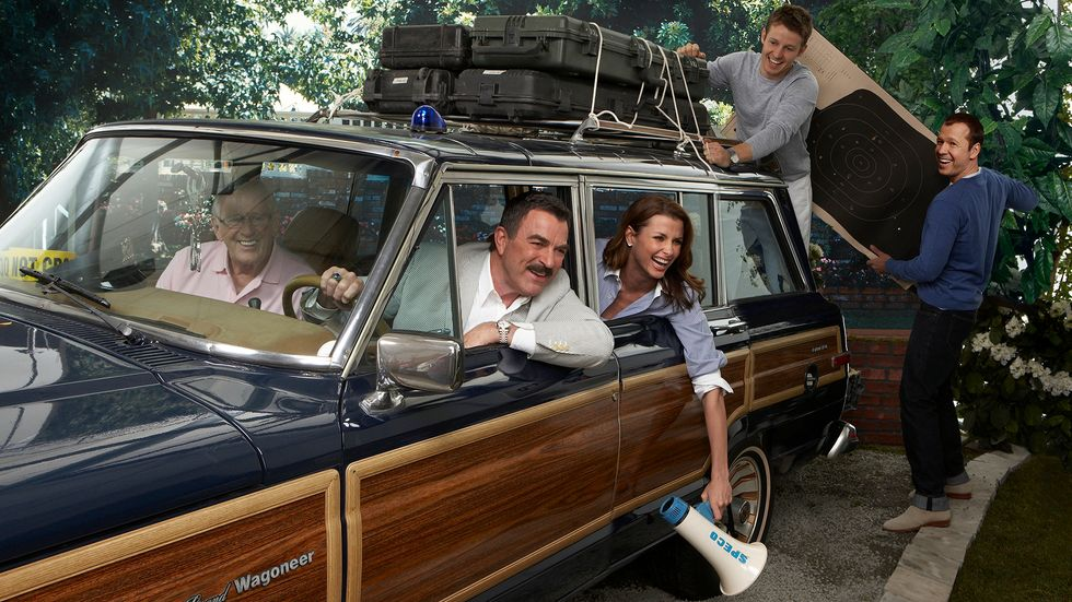 Cast of Blue Bloods in station wagon