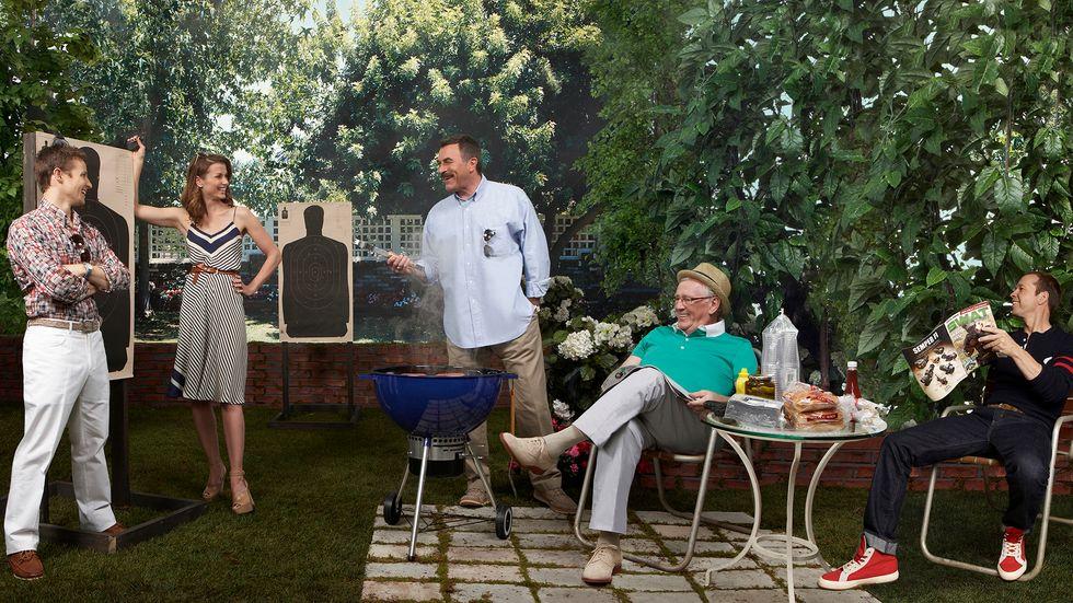 Cast of Blue Bloods grilling in backyard
