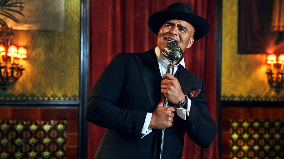Christopher Jackson singing into microphone