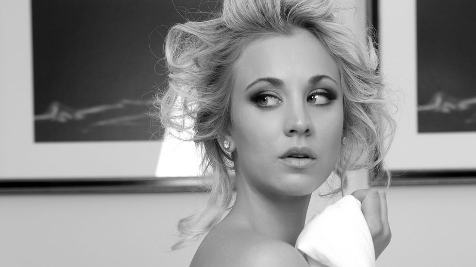 Kaley Cuoco wrapped in bed sheets