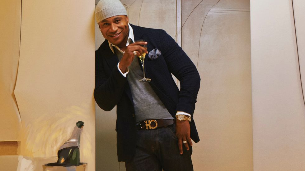 LL COOL J of NCIS Los Angeles in gray knit beanie drinking champagne