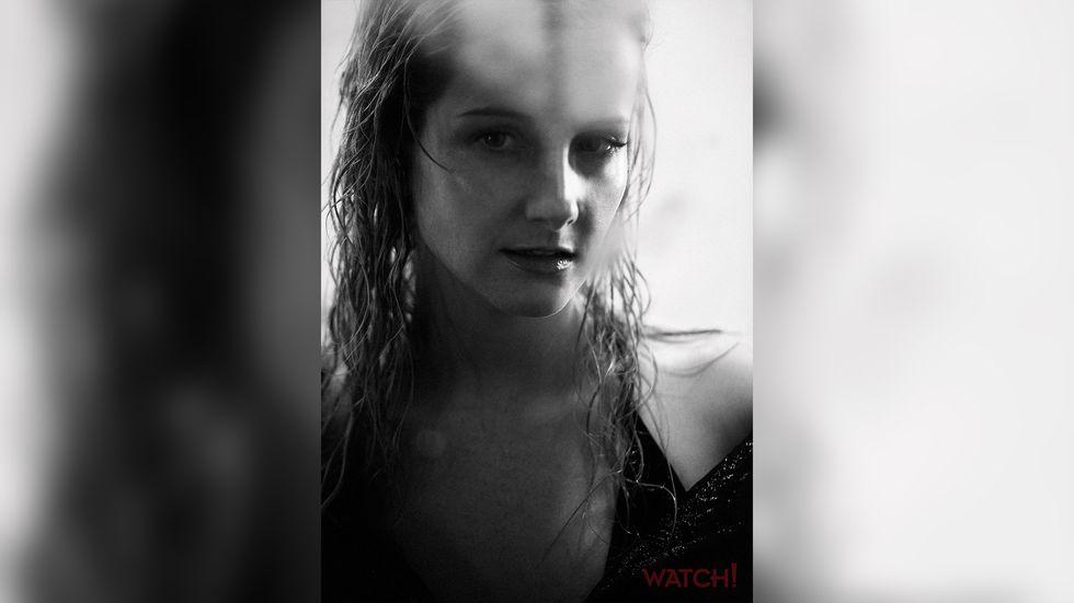 Melissa Rauch looking at camera black and white