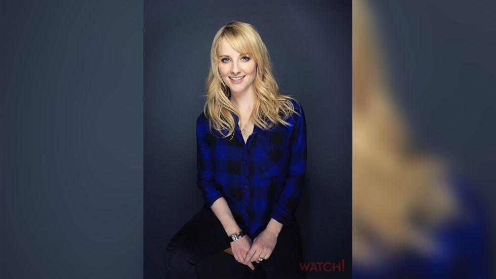 Melissa Rauch wearing a blue plaid shirt long blonde hair