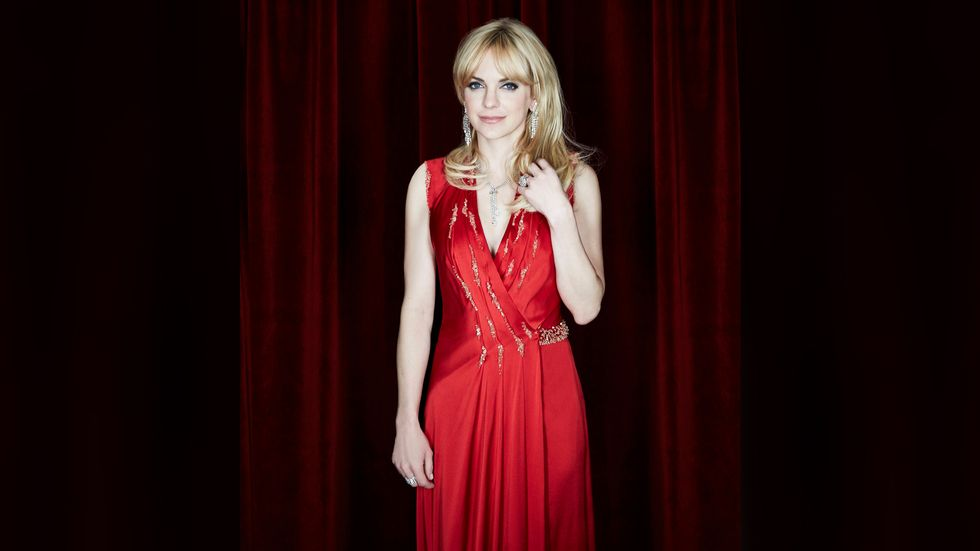 Anna Faris of Mom in red embellished satin gown