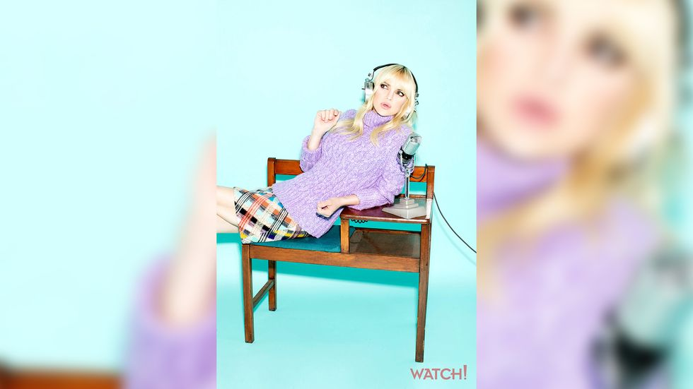 Anna Faris of Mom wearing headphones and a cozy purple sweater