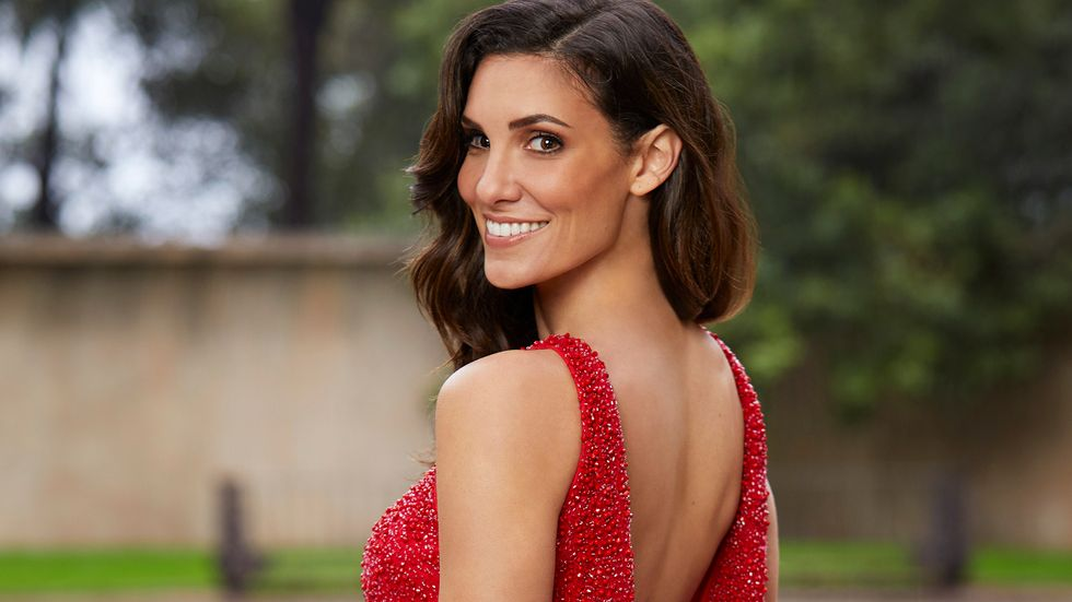 Daniela Ruah of NCIS Los Angeles with over the shoulder smile