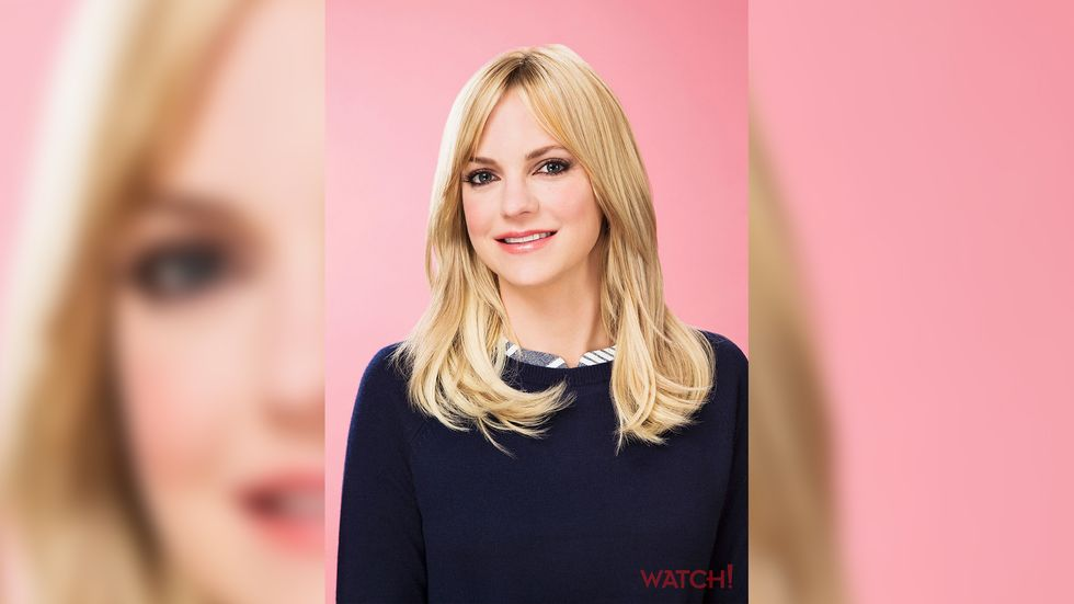 Anna Faris of Mom in preppy navy sweater