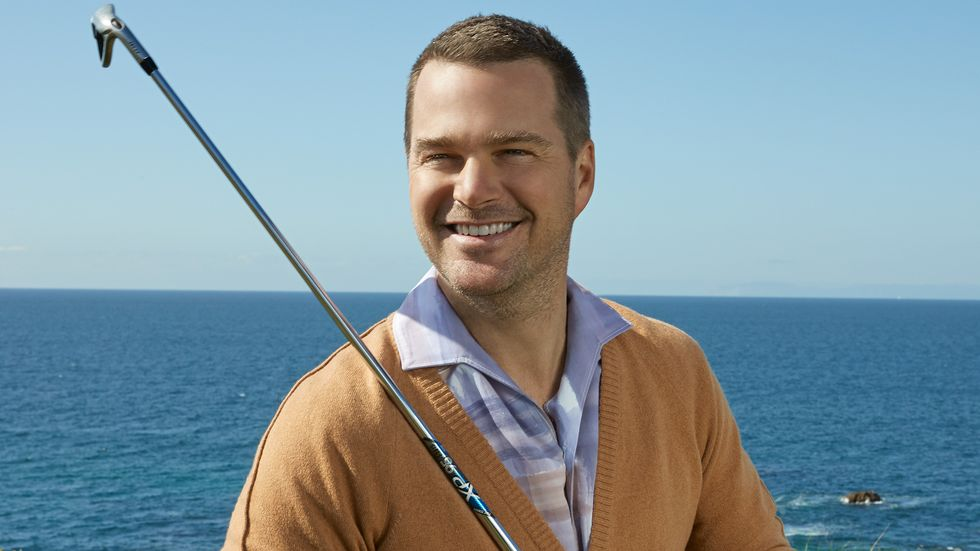 Chris ODonnell of NCIS Los Angeles holding a golf club