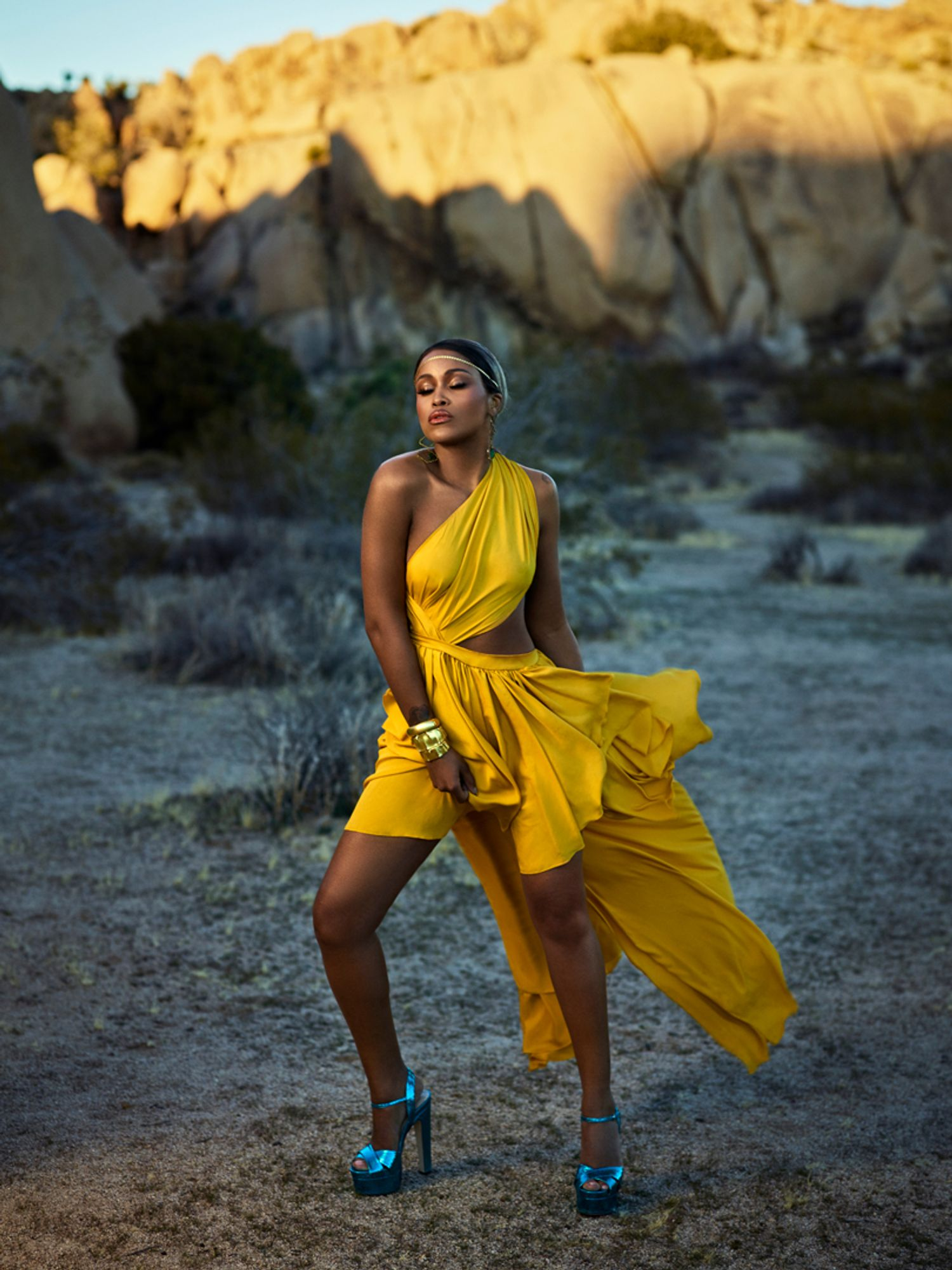 Eve of The Talk in a one shouldered yellow dress and blue shoes