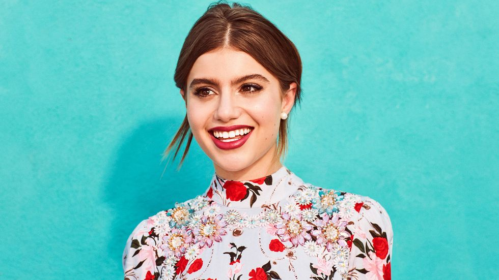 Sami Gayle of Blue Bloods in a bright floral shirt
