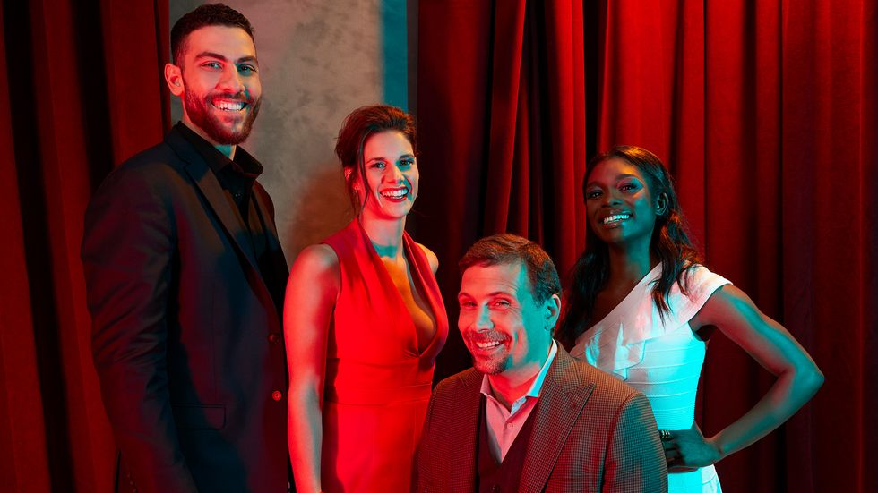 Cast of FBI in front of red curtains