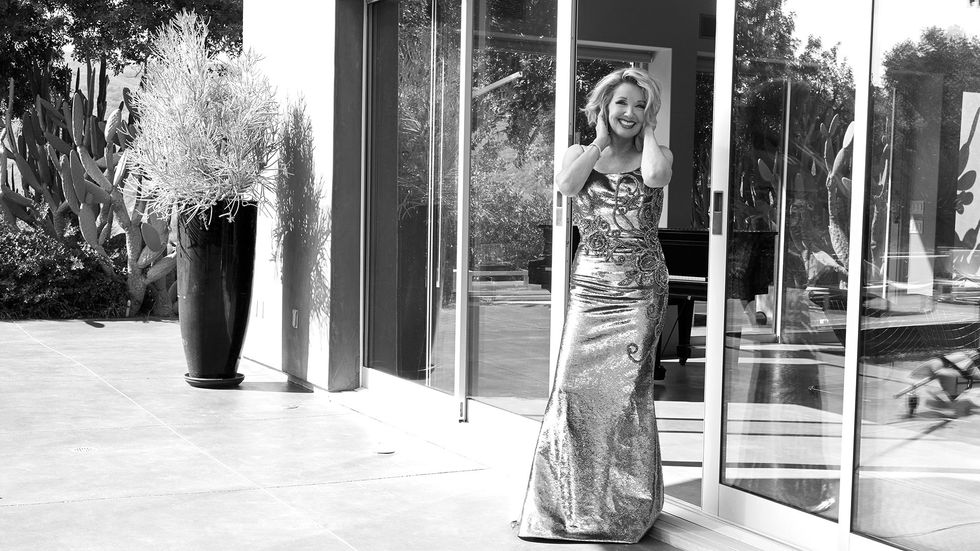 Melody Thomas Scott of The Young and the Restless in an evening gown on a patio