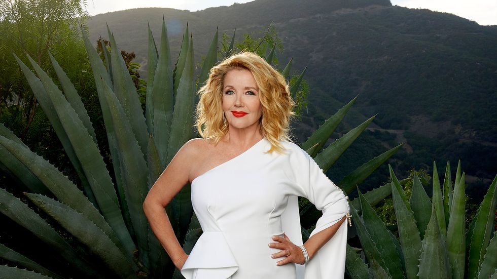 Melody Thomas Scott of The Young and the Restless in a white gown with red lipstick