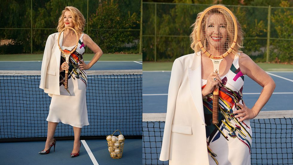 Melody Thomas Scott of The Young and the Restless in a colorful dress with a tennis racquet