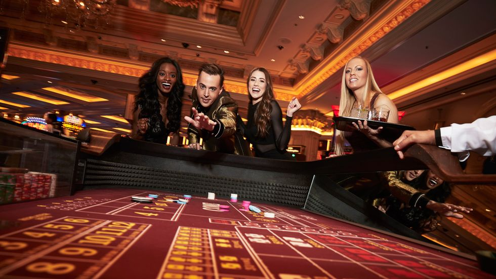 Sean Murray at a craps table with three women