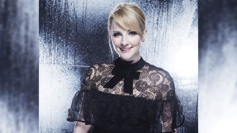 Melissa Rauch of The Big Bang Theory in black lace dress with velvet bow