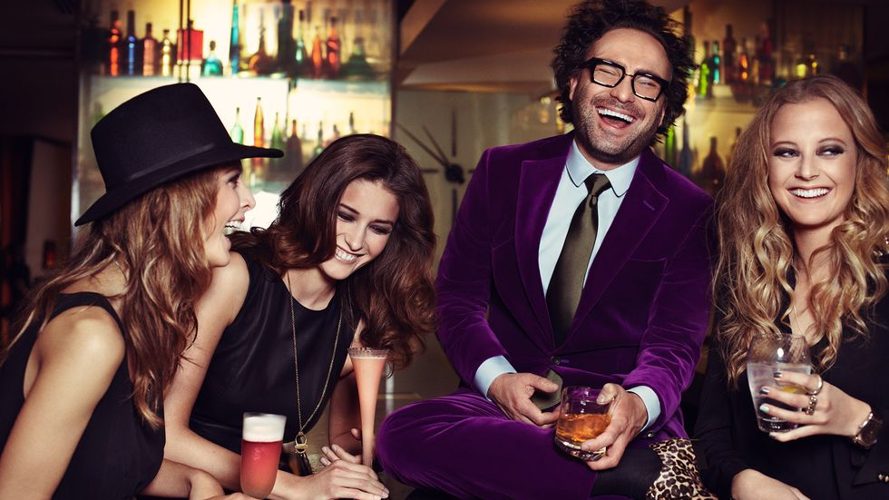 Johnny Galecki laughing with friends
