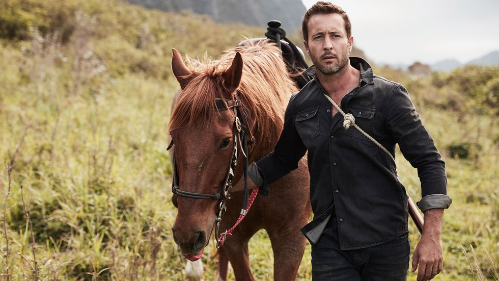 Alex O'Loughlin walking with a horse
