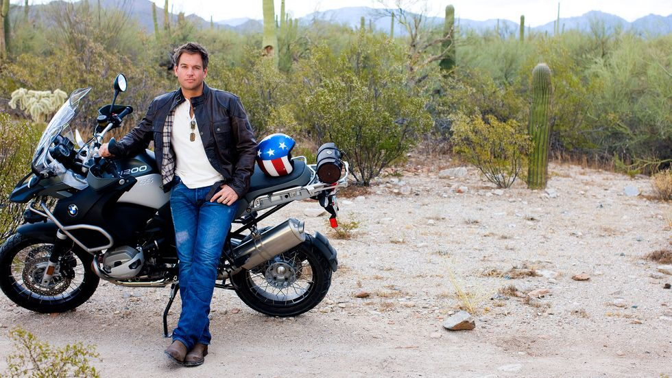 Michael Weatherly with a motorcylce in the desert