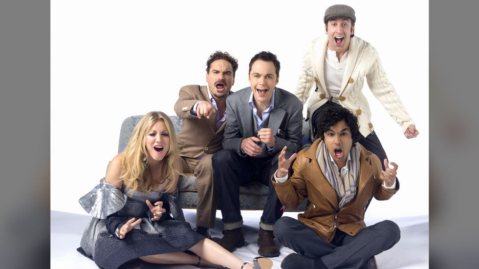 Big Bang Theory cast sitting on couch yelling at camera