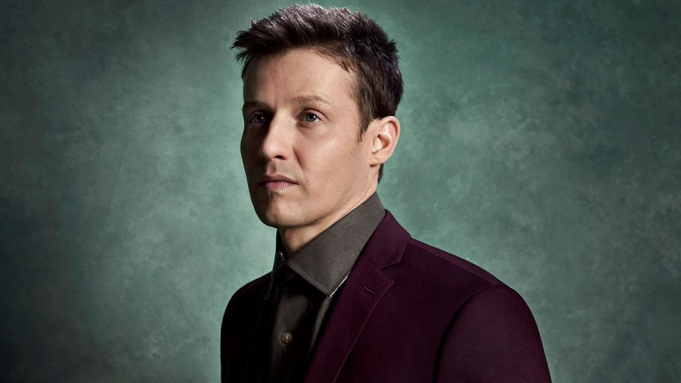 Will Estes wearing burgundy blazer