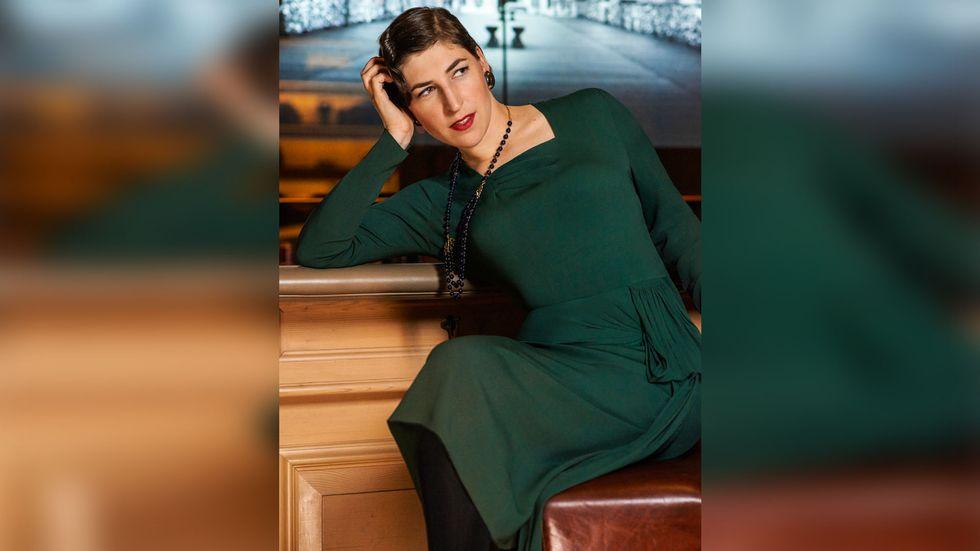Mayim Bialik of The Big Bang Theory in emerald green vintage dress