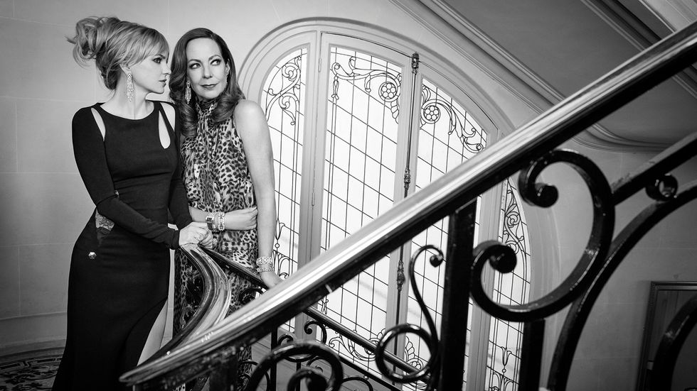 Anna Faris and Allison Janney of Mom in formal gowns on a staircase