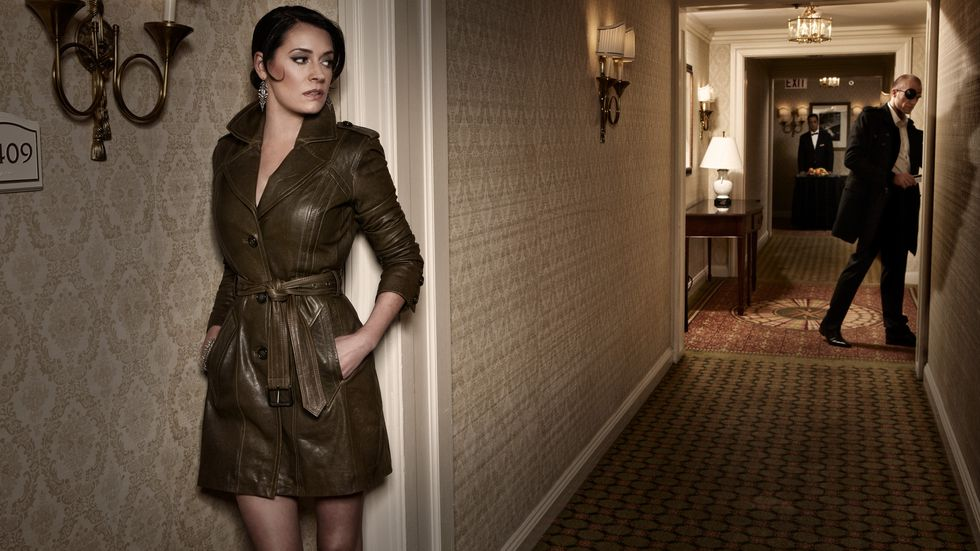 Paget Brewster of Criminal Minds in an olive leather trench coat